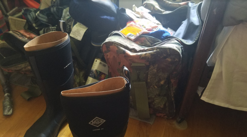Two Suitcases and Muck Boots